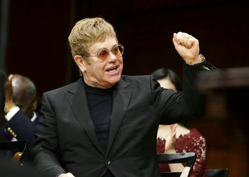 Musician Elton John gestures before being presented with the Harvard Humanitarian of the Year Award during ceremonies Monday, Nov. 6, 2017, on the campus of Harvard University, in Cambridge, Mass. John was recognized during the ceremonies for his work in fighting HIV/AIDS around the world.