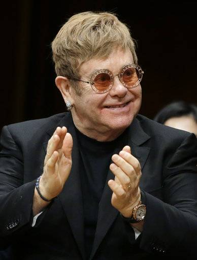 Musician Elton John applauds before being presented with the Harvard Humanitarian of the Year Award during ceremonies Monday, Nov. 6, 2017, on the campus of Harvard University, in Cambridge, Mass. Elton John was recognized during the ceremonies for his longtime work in fighting HIV/AIDS around the world.