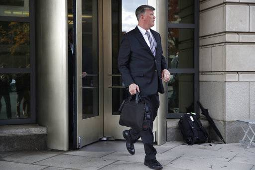 Kevin Downing, attorney for President Donald Trump's former campaign chairman Paul Manafort, leaves the federal courthouse, Monday, Nov. 6, 2017, in Washington.