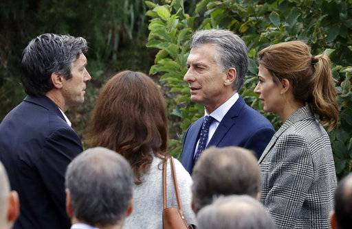 Guillermo Banchini, left, a survivor of the bike path terrorist attack, speaks with Argentine President Mauricio Macri and first lady Juliana Awada at the site of the attack, Monday, Nov. 6, 2017, in New York. Five Argentinians were among eight people killed by the terrorist who drove a truck down the bike path on Tuesday, Oct. 31.