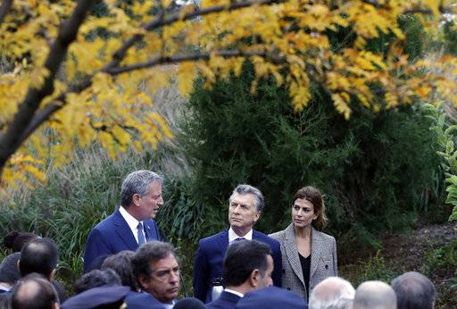 New York Mayor Bill de Blasio, left, and Argentine President Mauricio Macri visit the site of the terrorist attack on bicyclists, Monday, Nov. 6, 2017, in New York. Five Argentine bicyclists were among eight people killed by the terrorist who drove a truck down the bike path on Tuesday, Oct. 31.