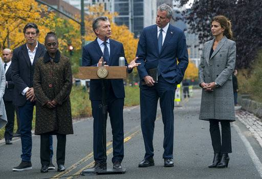 Mauricio Macri, President of Argentina, speaks during a tribute Monday, Nov. 6, 2017, on the same bike where five citizens from Argentina where struck and killed by a rental truck driver Tuesday, Oct. 31, in New York. From left are Chirlane McCray, First Lady and wife of Mayor Bill de Blasio, Marci, New York Mayor Bill de Blasio, and Juliana Awada, wife of President Marci.