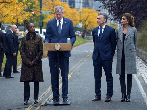 New York Mayor Bill de Blasio, speaks during a tribute Monday, Nov. 6, 2017, on the same bike where five citizens from Argentina where struck and killed by a rental truck driver Tuesday, Oct. 31, in New York. From left are Chirlane McCray, First Lady and wife of Mayor Bill de Blasio, de Blasio, Mauricio Macri, President of Argentina Juliana Awada, wife of President Marci.