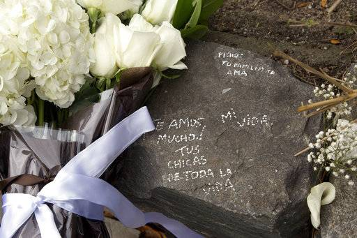 Messages have been written next to flowers left by Argentine President Mauricio Macri and New York Mayor Bill de Blasio at the site of the terrorist attack on bicyclists, Monday, Nov. 6, 2017, in New York. Five Argentine bicyclists were among eight people killed by the terrorist who drove a truck down the bike path on Tuesday, Oct. 31.