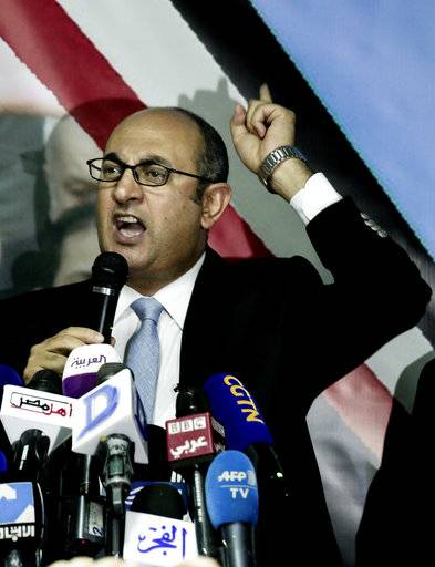 Egyptian activist lawyer Khaled Ali, announces his candidacy in next year's presidential election, during a press conference at the headquarters of the opposition al-Dustour party, in Cairo, Egypt, Monday, Nov. 6, 2017.