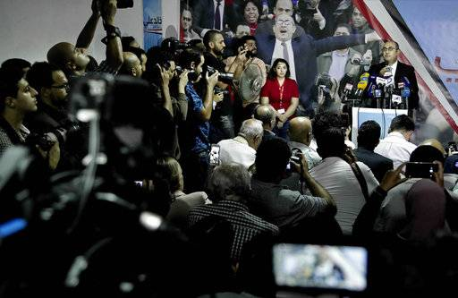 Egyptian activist lawyer Khaled Ali, at podium, prepares to speak during a press conference announcing his candidacy for next year's presidential election, at the headquarters of the opposition al-Dustour party, in Cairo, Egypt, Monday, Nov. 6, 2017.