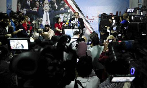 Egyptian activist lawyer Khaled Ali, at podium announces his candidacy in next year's presidential election, during a press conference at the headquarters of the opposition al-Dustour party, in Cairo, Egypt, Monday, Nov. 6, 2017.