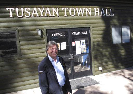 Tusayan Mayor Craig Sanderson stands outside the town's office on Wednesday, Nov. 1, 2017 in Tusayan, Ariz.. Residents are voting on a ballot measure to increase building heights in the small town outside the Grand Canyon's South Rim entrance.