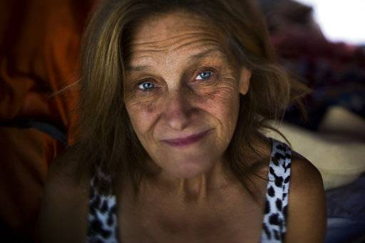 "Tammy Stephen, 54, poses for a photo Tuesday, Sept. 26, 2017, in Seattle. Stephen lives in Camp Second Chance, a city-sanctioned homeless encampment in Seattle. ""Housing here is out of control. That's why we have so many people on the street,"" she said. ""There's nowhere for them to go."""