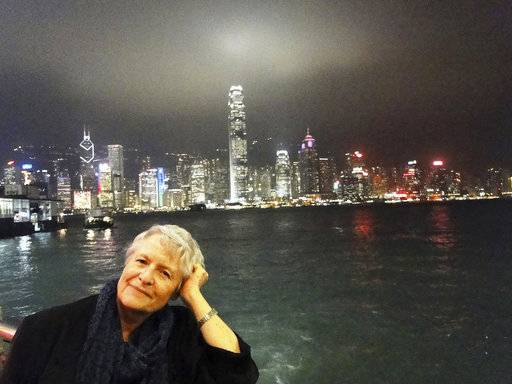 In this 2012 photo provided by Paul Linnee, his sister, former Associated Press journalist Susan Linnee, poses in Hong Kong. Linnee, who rose from a radio stringer in Latin America to become a groundbreaking AP bureau chief in Madrid and Nairobi, has died. She was 75. (Paul Linnee via AP)
