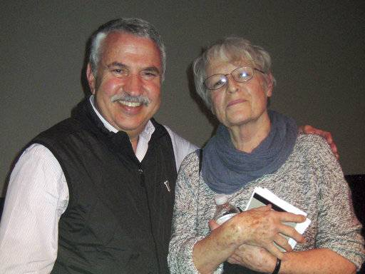 In this undated photo provided by Paul Linnee, his sister, former Associated Press journalist Susan Linnee, poses with New York Times columnist Thomas L. Friedman. Both Linnee and Friedman graduated from St. Louis Park High School in suburban Minneapolis. Linnee, who rose from a radio stringer in Latin America to become a groundbreaking AP bureau chief in Madrid and Nairobi, has died. She was 75. (Paul Linnee via AP)