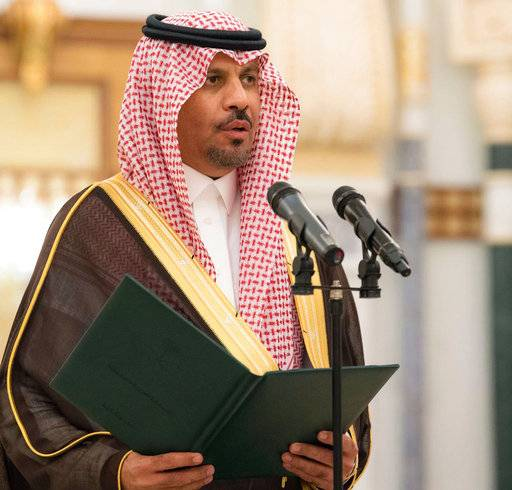 In this photo provided by the Saudi Press Agency, the new National Guard chief Prince Khalid bin Ayyaf al-Muqrin is sworn in before King Salman, in Riyadh, Saudi Arabia, Monday, Nov. 6, 2017. The king has sworn in new officials to take over from a powerful prince and former minister believed to be detained in a large-scale sweep that has shocked the country and upended longstanding traditions within the ruling family. (Saudi Press Agency, via AP)