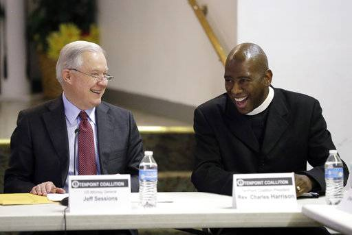 U.S. Attorney General Jeff Sessions, left, talks with Rev. Charles Harrison before speaking to the Indianapolis Ten Point Coalition, Nov. 6, 2017, in Indianapolis.