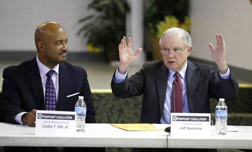 U.S. Attorney General Jeff Sessions, right, speaks to members of the Indianapolis Ten Point Coalition as Indiana Attorney General Curtis Hill listens, Nov. 6, 2017, in Indianapolis. The group is known for its campaigns to stem violence in crime-plagued neighborhoods.