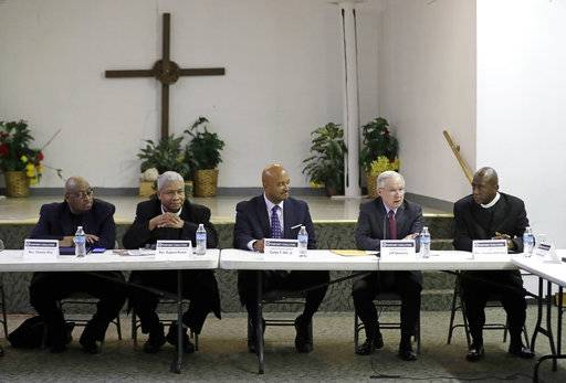 U.S. Attorney General Jeff Sessions, second from right, speaks to members of the Indianapolis Ten Point Coalition, Nov. 6, 2017, in Indianapolis. The group is known for its campaigns to stem violence in crime-plagued neighborhoods.