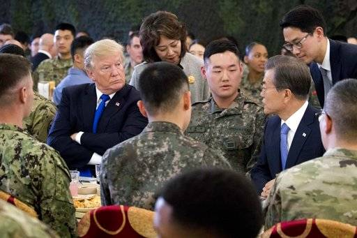 President Donald Trump, left, and South Korean President Moon Jae-in, right, have lunch with U.S. and South Korean troops at Camp Humphreys in Pyeongtaek, South Korea, Tuesday, Nov. 7, 2017. Trump is on a five country trip through Asia traveling to Japan, South Korea, China, Vietnam and the Philippines.