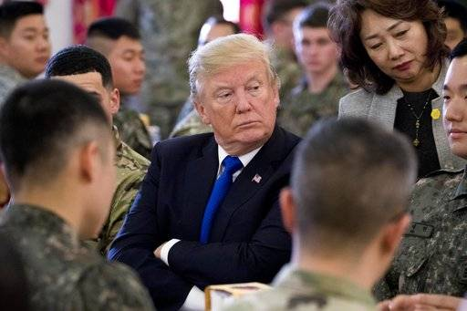 President Donald Trump has lunch with U.S. and South Korean troops along with South Korean President Moon Jae-in at Camp Humphreys in Pyeongtaek, South Korea, Tuesday, Nov. 7, 2017. Trump is on a five country trip through Asia traveling to Japan, South Korea, China, Vietnam and the Philippines.