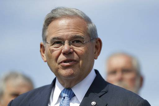 FILE - In this Aug. 17, 2017 file photo, Sen. Bob Menendez, D-N.J., speaks during a news conference, in Union Beach, N.J. A jury could begin deliberations Monday, Nov. 6, in the bribery trial of Menendez and a wealthy friend.