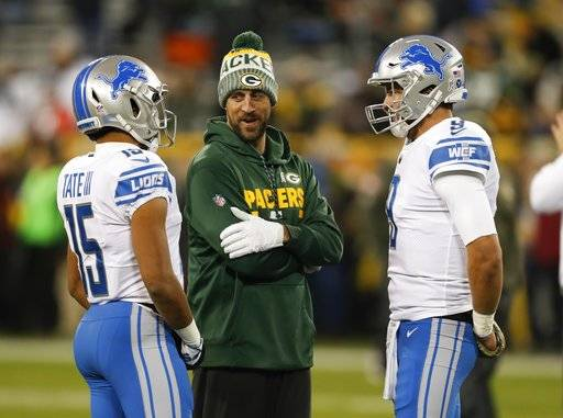 Green Bay Packers' Aaron Rodgers talks to Detroit Lions' Golden Tate and Matthew Stafford before an NFL football game Monday, Nov. 6, 2017, in Green Bay, Wis.