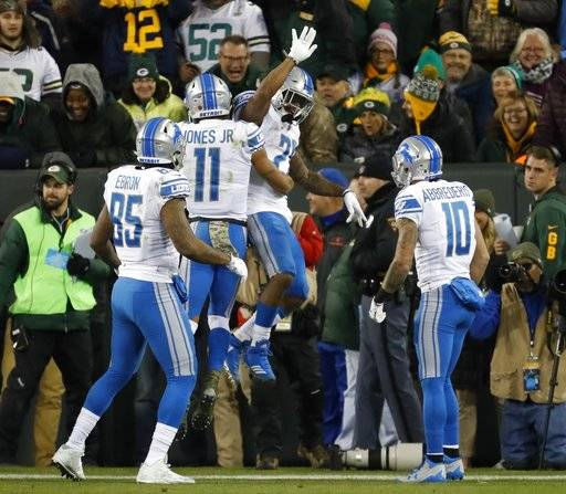 Detroit Lions' Ameer Abdullah celebrates his touchdown run with teammate Marvin Jones (11) during the first half of an NFL football game against the Green Bay Packers Monday, Nov. 6, 2017, in Green Bay, Wis.