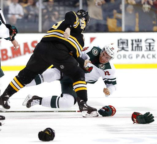 Boston Bruins' Matt Beleskey knocks Minnesota Wild's Luke Kunin to the ice during a fight in the first period of an NHL hockey game in Boston Monday, Nov. 6, 2017.