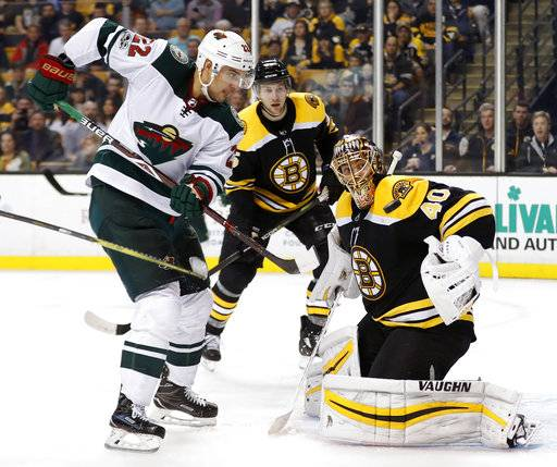 Boston Bruins goalie Tuukka Rask makes a save as Minnesota Wild's Nino Niederreiter looks for the rebound during the third period of Boston's 5-3 win in an NHL hockey game in Boston Monday, Nov. 6, 2017.
