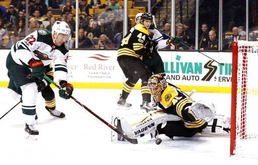 Minnesota Wild's Nino Niederreiter (22) scores on Boston Bruins goalie Tuukka Rask during the first period of an NHL hockey game in Boston Monday, Nov. 6, 2017.