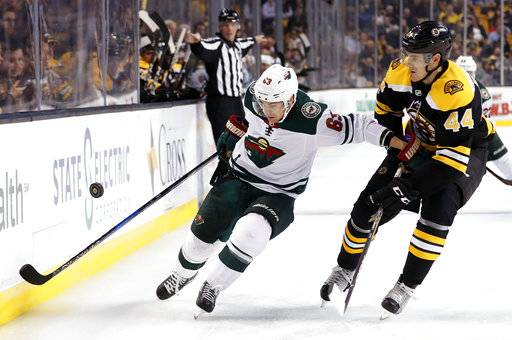 Minnesota Wild's Tyler Ennis tries to hold off Boston Bruins defenseman Rob O'Gara (44) during the first period of an NHL hockey game in Boston Monday, Nov. 6, 2017.