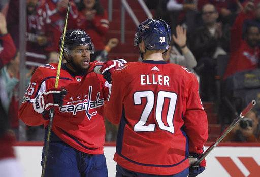 Washington Capitals right wing Devante Smith-Pelly (25) celebrates his goal with center Lars Eller (20), of Denmark, during the first period of an NHL hockey game against the Arizona Coyotes, Monday, Nov. 6, 2017, in Washington.
