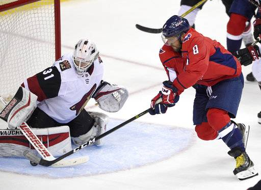 Washington Capitals left wing Alex Ovechkin (8), of Russia, tries to get the puck past Arizona Coyotes goalie Scott Wedgewood (31) during the third period of an NHL hockey game, Monday, Nov. 6, 2017, in Washington. The Capitals won 3-2 in overtime.