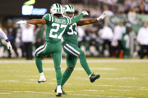 In this Thursday, Nov. 2, 2017, photo, New York Jets cornerback Darryl Roberts (27) and strong safety Jamal Adams (33) dance between plays during the second half of an NFL football game against the Buffalo Bills in East Rutherford, N.J. Playing under the bright lights of MetLife Stadium--just a few miles across the Hudson River from Broadway--Demario Davis, Adams, Darron Lee and the rest of the Jets' D shook off their previous fourth-quarter struggles with some serious dance moves.