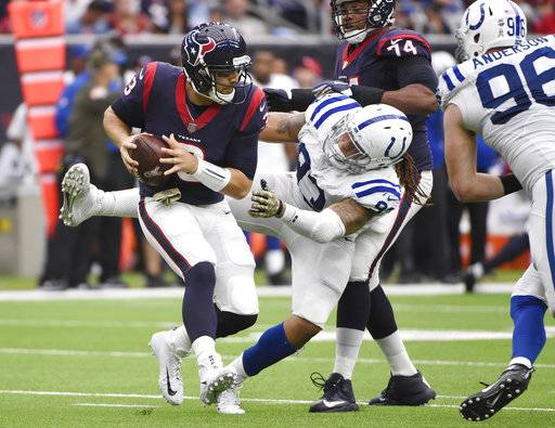 Houston Texans quarterback Tom Savage (3) is hit in the backfield by Indianapolis Colts outside linebacker Jabaal Sheard (93) during the second half of an NFL football game Sunday, Nov. 5, 2017, in Houston.