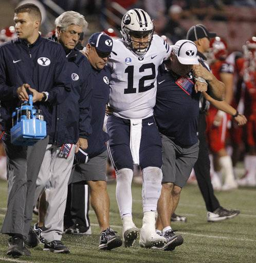 BYU's quarterback Tanner Mangum is helped off the field with an injury against Fresno State during the second half of an NCAA college football game in Fresno, Calif., Saturday, Nov. 4, 2017. Fresno State won the game 20-13.
