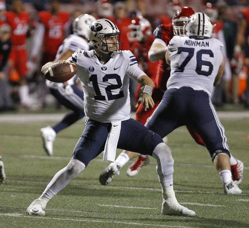 BYU's quarterback Tanner Mangum drops back to pass against Fresno State during the second half of an NCAA college football game in Fresno, Calif., Saturday, Nov. 4, 2017. Fresno State won the game 20-13.