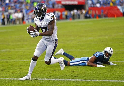 Baltimore Ravens wide receiver Mike Wallace (17) catches a 1-yard touchdown pass ahead of Tennessee Titans defensive back Logan Ryan (26) in the second half of an NFL football game Sunday, Nov. 5, 2017, in Nashville, Tenn. The Titans won 23-20.