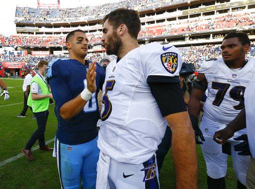 Tennessee Titans quarterback Marcus Mariota (8) talks with Baltimore Ravens quarterback Joe Flacco (5) after an NFL football game Sunday, Nov. 5, 2017, in Nashville, Tenn. The Titans won 23-20.