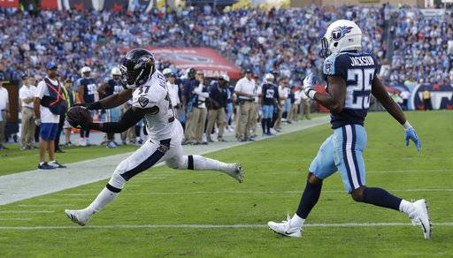 Baltimore Ravens running back Javorius Allen (37) catches a 3-yard touchdown pass ahead of Tennessee Titans cornerback Adoree' Jackson (25) in the second half of an NFL football game Sunday, Nov. 5, 2017, in Nashville, Tenn.
