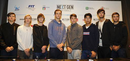 From left, U.S. Jared Donaldson, Denis Shapovalov of Canada, Andrey Rublev of Russia, Daniil Medvedev of Russia, Gianluigi Quinzi of Italy, Hyeon Chung of Korea, Karen Khachanov of Russia and Borna Coric of Croatia, pose prior to a press conference to present the ATP Next Gen Finals tennis tournament, featuring the eight qualifiers, in Milan, Italy, Monday, Nov. 6, 2017.