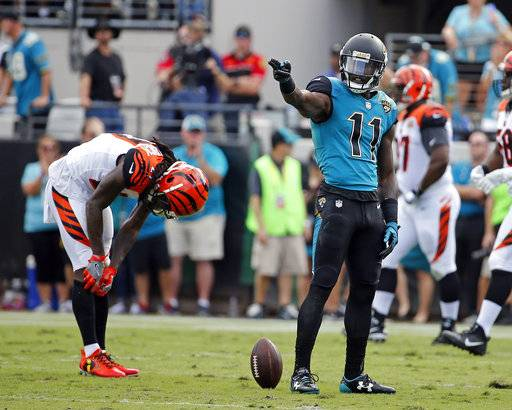 Jacksonville Jaguars wide receiver Marqise Lee (11) points after making a first down against the Cincinnati Bengals during the first half of an NFL football game, Sunday, Nov. 5, 2017, in Jacksonville, Fla.