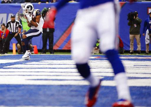 Los Angeles Rams wide receiver Robert Woods (17) catches a pass for a touchdown during the second half of an NFL football game against the New York Giants, Sunday, Nov. 5, 2017, in East Rutherford, N.J.