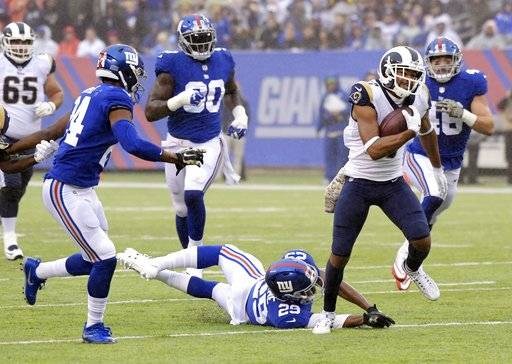 Los Angeles Rams' Robert Woods (17) breaks a tackle by New York Giants' Nat Berhe (29) to run for a touchdown during the first half of an NFL football game, Sunday, Nov. 5, 2017, in East Rutherford, N.J.