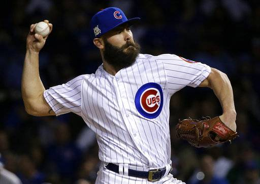 FILE - In this Wednesday, Oct. 18, 2017 file photo, Chicago Cubs starting pitcher Jake Arrieta throws during the first inning of Game 4 of baseball's National League Championship Series against the Los Angeles Dodgers in Chicago. Jake Arrieta and Wade Davis were among nine free agents who have received $17.4 million qualifying offers from their teams, Monday, Nov. 6, 2017.