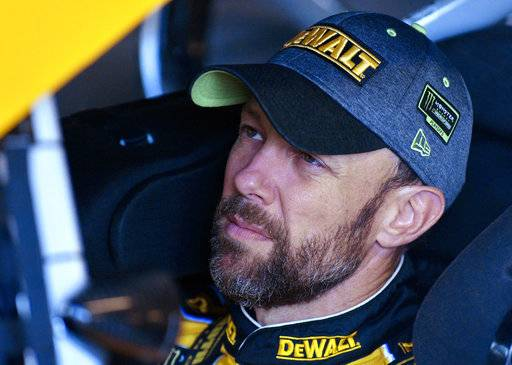 FILE - In this Oct. 20, 2017, file photo, Matt Kenseth sits in his car as he waits to practice for a NASCAR Series Cup auto race at Kansas Speedway in Kansas City, Kan. Kenseth says he will be taking time off in 2018, though the former NASCAR Cup Series champion isn't using the word retirement.