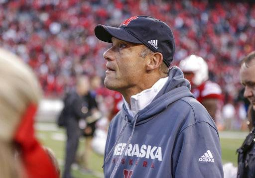 Nebraska head coach Mike Riley looks at the score board as he walks off the field following an NCAA college football game against Northwestern in Lincoln, Neb., Saturday, Nov. 4, 2017. Northwestern won 31-24 in overtime.