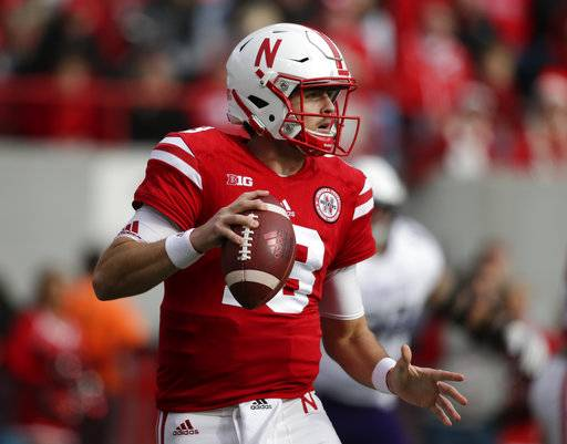 Nebraska quarterback Tanner Lee (13) looks for a receiver during the first half of an NCAA college football game against Northwestern in Lincoln, Neb., Saturday, Nov. 4, 2017.