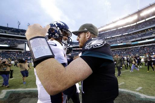 Philadelphia Eagles' Carson Wentz, right, and Denver Broncos' Brock Osweiler meet after an NFL football game, Sunday, Nov. 5, 2017, in Philadelphia.