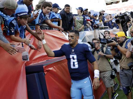 Tennessee Titans quarterback Marcus Mariota (8) slaps hands with fans after an NFL football game against the Baltimore Ravens Sunday, Nov. 5, 2017, in Nashville, Tenn. The Titans won 23-20.
