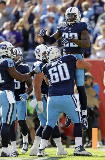 Tennessee Titans running back Derrick Henry (22) celebrates with center Ben Jones (60) after Henry scored a touchdown on a 1-yard run against the Baltimore Ravens in the first half of an NFL football game Sunday, Nov. 5, 2017, in Nashville, Tenn.