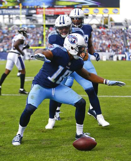 Tennessee Titans wide receiver Rishard Matthews (18) celebrates after catching a 16-yard touchdown against the Baltimore Ravens in the first half of an NFL football game Sunday, Nov. 5, 2017, in Nashville, Tenn.