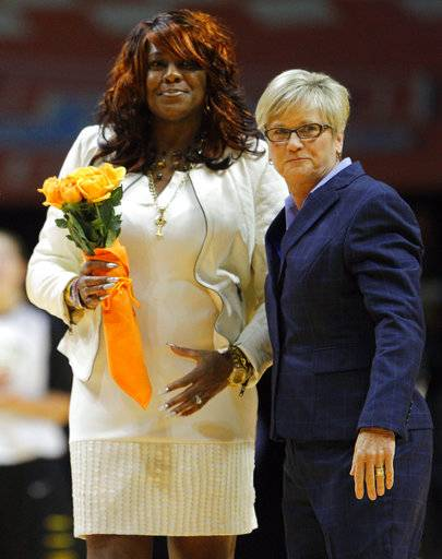 FILE - In this Dec. 16, 2014, photo, Bridgette Gordon, left, meets with Tennessee head coach Holly Warlick, right, before an NCAA college women's basketball game in Knoxville, Tenn. Gordon starred on two of Tennessee's national championship teams and reached the Final Four each of her four seasons with Tennessee. Now the U.S. Olympic gold medalist is back at her alma mater as an assistant coach trying to help Tennessee regain the prominence it enjoyed during her own playing career. (Wade Payne/The News Sentinel via AP)